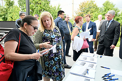 After departing the train Rose Delvicchio (left), of Collingswood, is one of the passengers helped with information about the upcoming temporary suspension for PTC installation on the Atlantic City Rail Line, at an information desk from NJ Transit, in Lindenwold, NJ, on Monday.