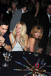 Left to right, Olivier Martinez, SIENNA MILLER and KELLY HOPPEN at a party to celebrate the launch of Hollywood Domino - a brand new board game, held at Mosimann's 11b West Halkin Street, London on 7th November 2008.  The evening was in aid of Charlize Theron's Africa Outreach Project.