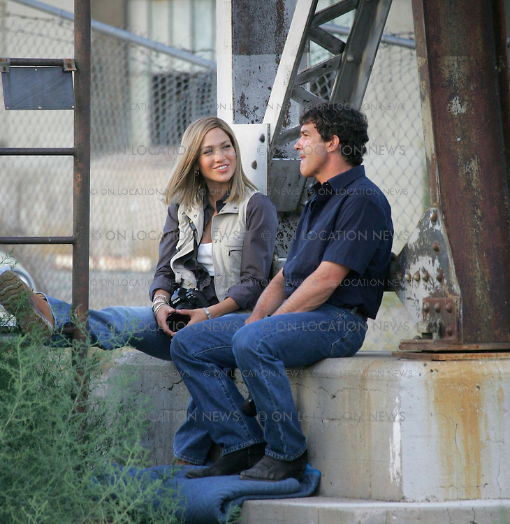 """July 22, 2005 Albuquerque, New Mexico **EXCLUSIVE** Jennifer Lopez and Antonio Banderas on the New Mexico set of """"Bordertown"""". Lopez and Banderas film some serious scenes but then laugh and smile in between takes. Lopez and Banderas's characters play reporters who go undercover in Juarez, Mexico to investigate the rapes and murders of women who work in factories (based on a true story). Sales: Eric Ford 1/818-613-3955 info@onlocationnews.com"""
