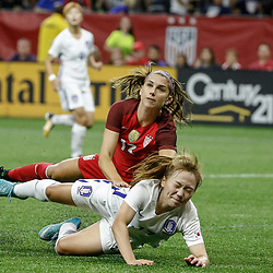 Oct 19, 2017; New Orleans, LA, USA; USA forward Lynn Williams (12) collides with Korea Republic Jang Seulgi (17) during the second half of an International Friendly Women's Soccer match at the Mercedes-Benz Superdome. Mandatory Credit: Derick E. Hingle-USA TODAY Sports
