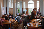St Ignatius volunteer run a soup kitchen for the local homless community. Most of the people attending are Polish men, looking for work.