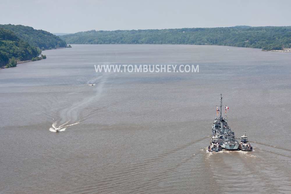 Highland, New York -The USS Slater passed Highland and Poughkeepsie on its way north on the Hudson River on June 30, 2014. The Slater served in World War II and is the last destroyer escort vessel afloat in America. The Slater was en route to Albany, N.Y., to resume its duties as a floating museum. The tugboats Frances, left, and Margot, assisted the Slater.