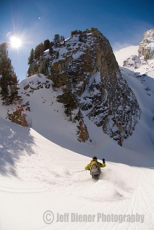 A young man skis into Shadow Peak Cirque in Grand Teton National Park, Jackson Hole, Wyoming.
