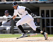 CHICAGO - AUGUST 31:  Leury Garcia of the Chicago White Sox bunts against the Detroit Tigers on August 31, 2014 at U.S. Cellular Field in Chicago, Illinois.  (Photo by Ron Vesely)