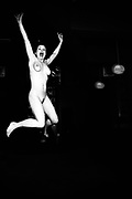 Naked pub goer jumping in the air in excitement, UK 2004