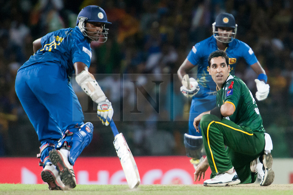 © Licensed to London News Pictures. 04/10/2012. Pakistani bowler Umar Gul on his knee as he looks back as the ball gets hit for four runs  during the World T20 Cricket Mens Semi Final match between Sri Lanka Vs Pakistan at the R Premadasa International Cricket Stadium, Colombo. Photo credit : Asanka Brendon Ratnayake/LNP