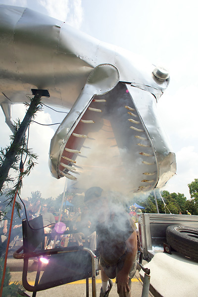 Stock photo of a metal dinosaur spewing smoke from its mouth