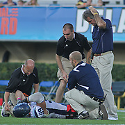University of Maine defensive lineman Michael Cole (99) is attended to by the University of Maine medical staff in second quarter of a Week 6 NCAA football game against Delaware.