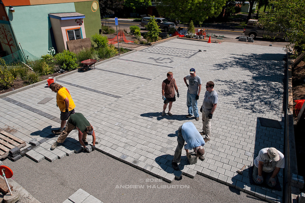 Volunteer work party laying pavers for the pervious pavement parking lot paving work meet (L-R): Pete Wilson, Rick Wasserloos, Fred Davis, Josh Lighthipe, Charles Heying, Dustin Elmore, Adam Zucker.  Café au Play at Tabor Commons, a project of the Southeast Uplift Neighborhood Coalition (SEUL) and volunteers from Portland's Mt Tabor neighborhood.