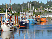 Fishing boats in Yaquina Bay, Newport, Oregon, United States.