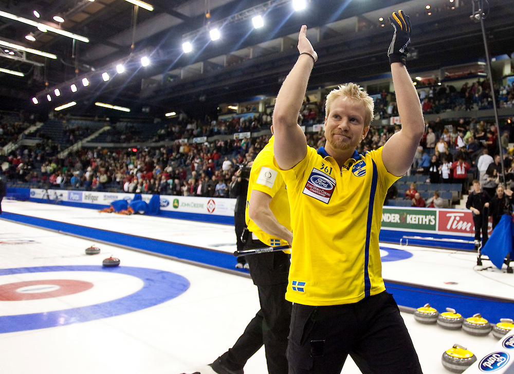 Swedish skip Niklas Edin, acknowledges the crowd following his  7-6 win over Norway in the bronze medal match at the Ford World Men's Curling Championships in Regina, Saskatchewan, April 10, 2011.<br /> AFP PHOTO/Geoff Robins