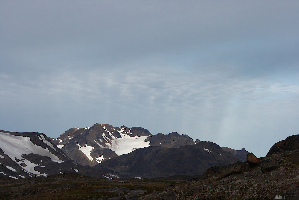 Strange light over the mountain behind Kulusuk, south-east Greenland