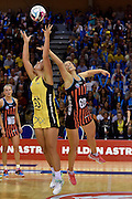 Pulse's Maia Wilson (L) jumps for the ball with Tactix's Jess Moulds during the ANZ Champs Pulse vs Tactix netball match at TSB Arena in Wellington on Sunday the 01 May 2016. Copyright Photo by Marty Melville / www.Photosport.nz