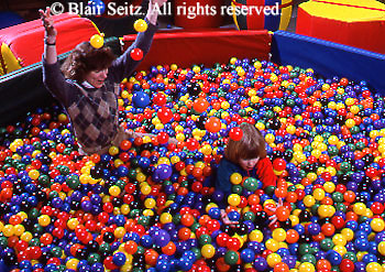 Medical , Occupational Therapy for Children, Therapy Apparatus, Child Plays in Pool of Balls, Therapist