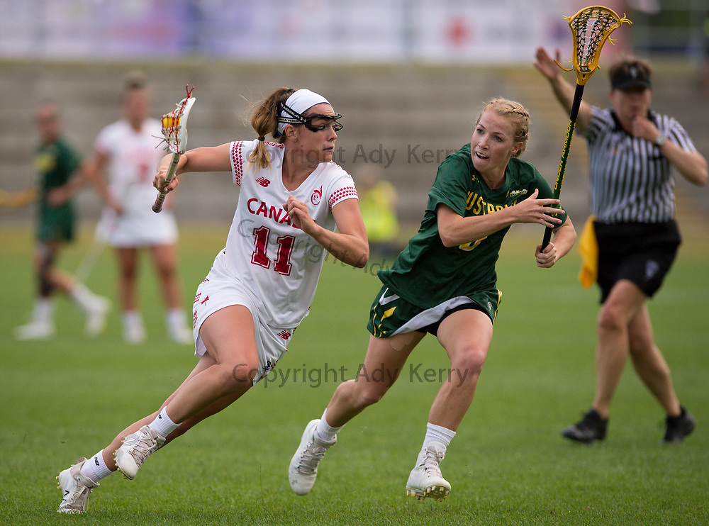 Canada's Erica Evans  challenges with Australia's Ashtyn Hiron during their opening game of the 2017 FIL Rathbones Women's Lacrosse World Cup, at Surrey Sports Park, Guildford, Surrey, UK, 13th July 2017.