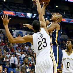 Oct 30, 2013; New Orleans, LA, USA; Indiana Pacers power forward David West (21) shoots over New Orleans Pelicans power forward Anthony Davis (23) during the first quarter of a game at New Orleans Arena. Mandatory Credit: Derick E. Hingle-USA TODAY Sports