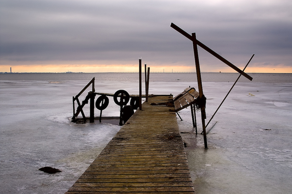 Bleak conditions and numbing temperatures suit the isolation of this weatherworn jetty.
