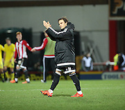 Brentford midfielder Sam Saunders applauding fans after game during the Sky Bet Championship match between Brentford and Leeds United at Griffin Park, London, England on 26 January 2016. Photo by Matthew Redman.