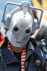 "© Licensed to London News Pictures. 23/11/2015. LONDON, UK. A person wears a Cyber Man mask as fans of Doctor Who known as ""Whovians"" and other supporters of the BBC gather outside Broadcasting House in central London to oppose the threat of 20% government cuts to the Corporation. Photo credit : Stephen Chung/LNP"