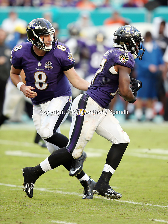 Baltimore Ravens running back Javorius Allen (37) takes a handoff from Baltimore Ravens quarterback Matt Schaub (8) as he runs the ball during the 2015 week 13 regular season NFL football game against the Miami Dolphins on Sunday, Dec. 6, 2015 in Miami Gardens, Fla. The Dolphins won the game 15-13. (©Paul Anthony Spinelli)
