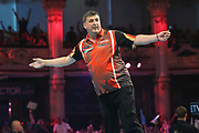 Mensur Suljovic hits a double and celebrates during the BetVictor World Matchplay Darts 2018 semi final at Winter Gardens, Blackpool, United Kingdom on 28 July 2018. Picture by Shane Healey.
