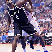 16 November 2013: Brooklyn Nets center Andray Blatche (0) vies for the rebound with Los Angeles Clippers center DeAndre Jordan (6) during the Los Angeles Clippers 110-103 victory over the Brooklyn Nets at the Staples Center, Los Angeles, California, USA.