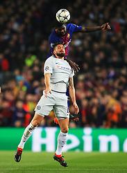 Samuel Umtiti of Barcelona wins a header above Olivier Giroud of Chelsea - Mandatory by-line: Matt McNulty/JMP - 14/03/2018 - FOOTBALL - Camp Nou - Barcelona, Catalonia - Barcelona v Chelsea - UEFA Champions League - Round of 16 Second Leg