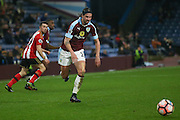 Burnley midfielder George Boyd (21)  chases the ball down during the The FA Cup third round replay match between Burnley and Sunderland at Turf Moor, Burnley, England on 17 January 2017. Photo by Simon Davies.