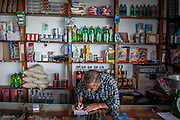 The owner of the small shop and combined coffee bar at the little mountain village of Sklavopoula located about 20 km from the city of Paleochora on the Greek island of Crete.