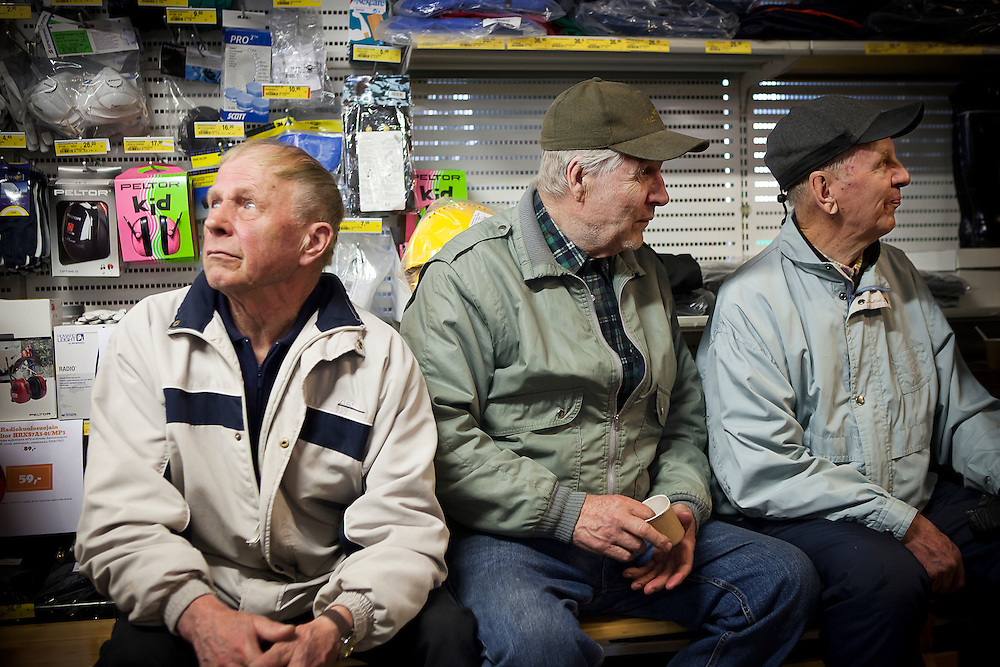 Locals gather to meet the head of the True Finns in a hardware store in Taavetti, Finland.