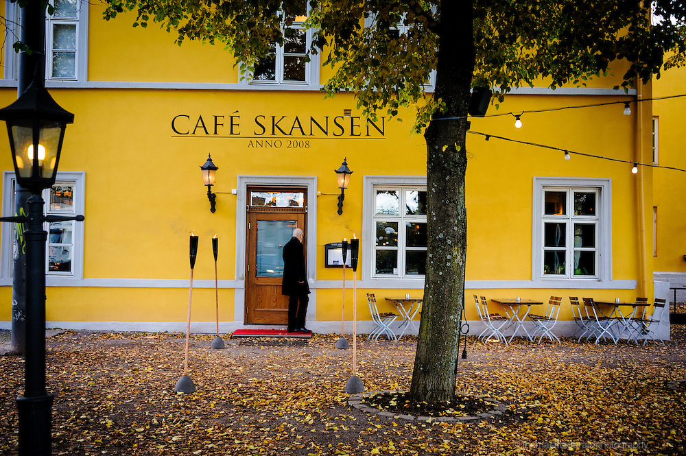 Oslo, Norway, October 2012: A customer enters the door of the Cafe Skansen.EDITORIAL ONLY: This Image is only for Editorial Use