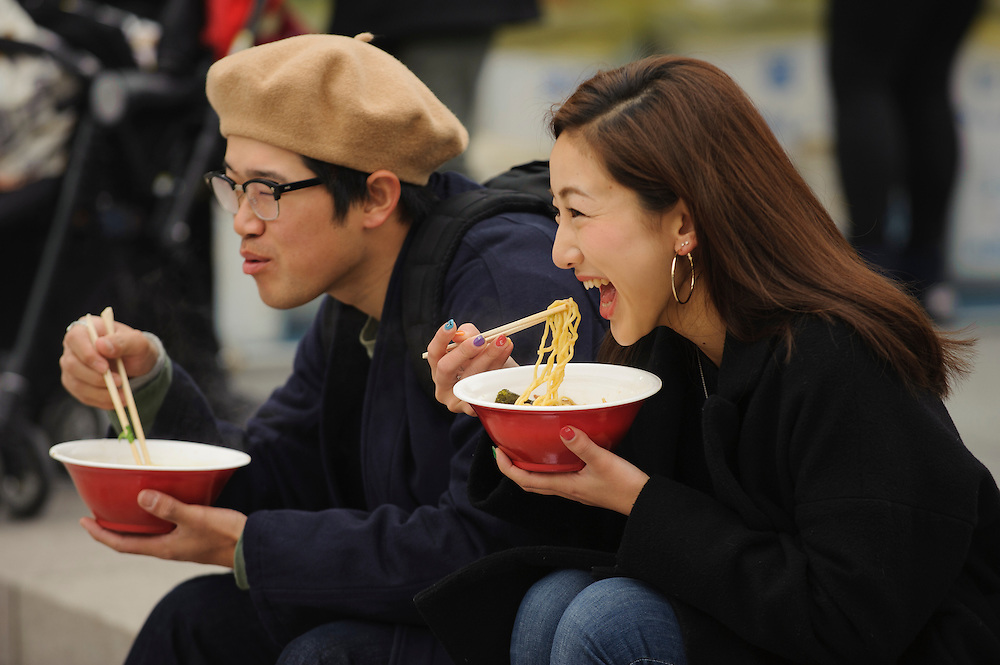 People eat ramen at  the 2016 Ramen Festival in Nagoya, Japan. Twelve different recipes of the famous Japanese noodle soup are represented at the five-day festival, with flavors from all over Japan, and one from Seattle, Washington.