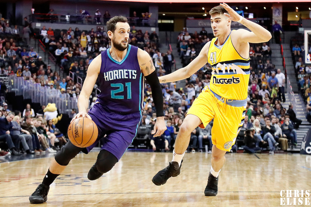 04 March 2017: Charlotte Hornets guard Marco Belinelli (21) drives past Denver Nuggets forward Juancho Hernangomez (41) during the Charlotte Hornets 112-102 victory over the Denver Nuggets, at the Pepsi Center, Denver, Colorado, USA.