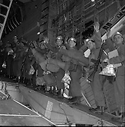 05/12/1961<br /> 12/05/1961<br /> 05 December 1961<br /> Troops of the 36th Battalion and General McKeown leave for the Congo from Dublin Airport. Image shows the troops boarding the aircraft.