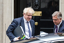 London, UK. 23 October, 2019. Prime Minister Boris Johnson leaves 10 Downing Street to attend his second session of Prime Minister's Questions in the House of Commons on the morning after Parliament rejected his fast-track timetable for ratifying his Brexit bill.