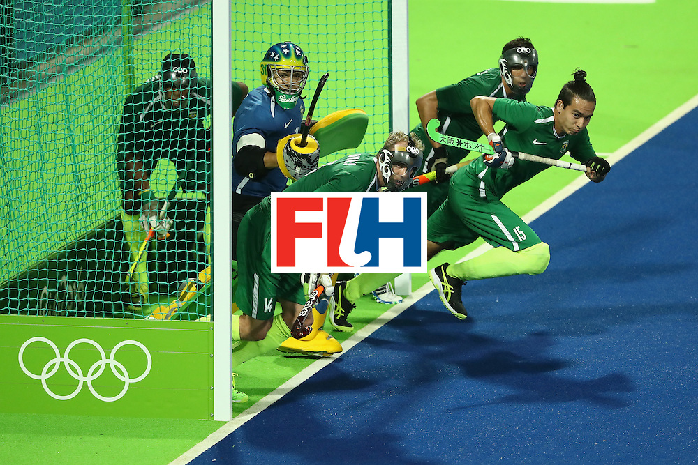 RIO DE JANEIRO, BRAZIL - AUGUST 06:  Bruno Bitencourt #13, Ernst Rost #14. Patrick van der Heijden #15, and Rodrigo Faustino #31 of Brazil run from the goal during a Men's Pool A match between Brazil and Spain on Day 1 of the Rio 2016 Olympic Games at the Olympic Hockey Centre on August 6, 2016 in Rio de Janeiro, Brazil.  (Photo by Sean M. Haffey/Getty Images)
