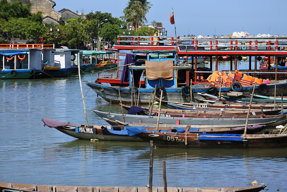 Boats moored on the river front in Hoi An