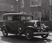 Cork's All-Ireland medal winner from 1903, Larry Flaherty driving his hackney in Cork city in the 1960's.