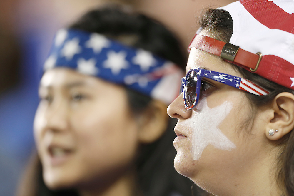 Feb 19, 2016; Houston, TX, USA; Fans watch USA Head play against Trinidad & Tobago in the first half during the semifinals of the 2016 CONCACAF women's Olympic soccer tournament at BBVA Compass Stadium.  Mandatory Credit: Thomas B. Shea-USA TODAY Sports