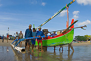 Fishermen prepare to launch their boats for a night of fishing off the coastline of Bali, Indonesia.