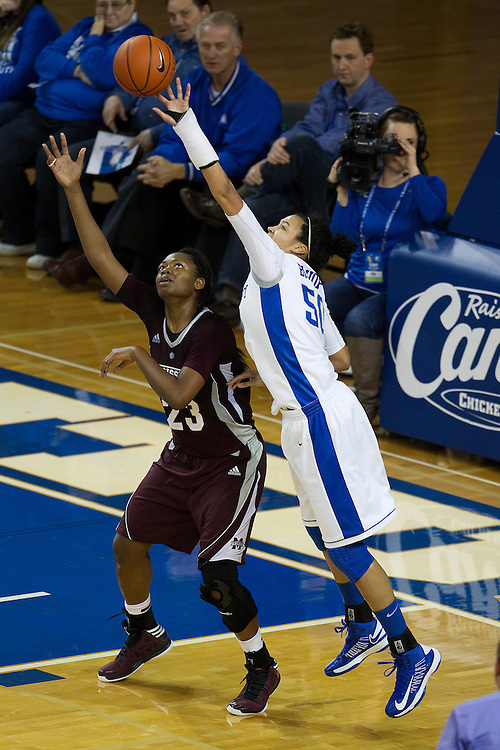 UK forward/center Azia Bishop, right, deflects an entry pass to Mississippi State forward Carnecia Williams in  the second half. The University of Kentucky Women hosted Mississippi State University Thursday, Jan. 17, 2013 at Memorial Coliseum in Lexington. Photo by Jonathan Palmer