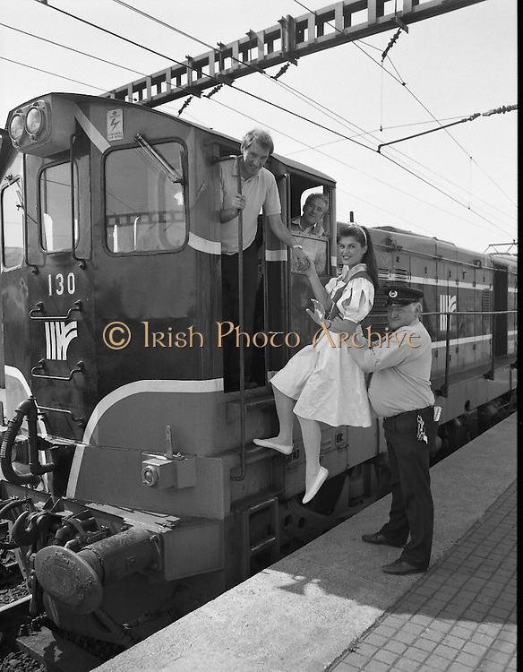 Mosney Holiday Express.   (S4)..1989..27.05.1989..05.27.1989..27th April 1989..The Mosney Holiday Express left Connolly Station,Dublin for its run to Mosney Holiday Camp, Co Meath. The express was sent on its way by Snow White who had left the seven dwarfs at the Olympia Theatre in Dublin. Two bears from the show in the Olympia helped Snow White send the train on its way...Snow White (Lorraine McCourt) is pictured getting a helping hand aboard the express by Iarnród Éireann Inspector,Eddie Manning. In the cabin are Engine Driver Charlie McMaster and Paddy Reid, Maintenance Supervisor.