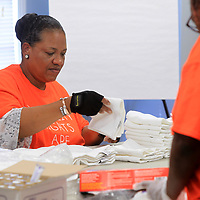 Brenda Mosley, of Smithville and an Arc member, folds bath cloths to go in comfort kits being assembled at the American Red Cross office in Tupelo Friday morning. The Arc members also donated some supplies for kits that are distributed during emergencies and natural disasters. The Tupelo office of The American Red Cross have gone through aal their comfort kits with so many recent disasters.