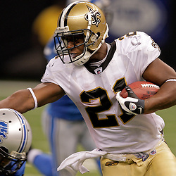 2009 September 13: New Orleans Saints running back Mike Bell (21) stiff arms Detroit Lions safety Louis Delmas (26) during a 45-27 win by the New Orleans Saints over the Detroit Lions at the Louisiana Superdome in New Orleans, Louisiana.