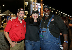 IMAGE DISTRIBUTED FOR SMITHFIELD - Smithfield judges Tuffy Stone, left, and Moe Cason, right, congratulate Suzanne Clark of Phoenix, AZ after winning the Smithfield Hog Wild Throwdown contest at the American Royal World Series of Barbecue on Saturday, Oct. 29, 2016 in Kansas City, Kansas. (Colin E. Braley/AP Images for Smithfield)