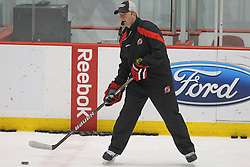 May 29; Newark, NJ, USA; New Jersey Devils head coach Peter DeBoer passes the puck during Stanley Cup Finals media practice day at the Prudential Center.