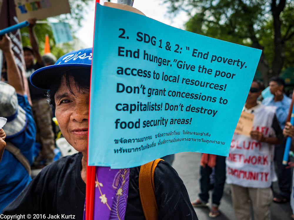 03 OCTOBER 2016 - BANGKOK, THAILAND: A woman marches in front of the UN headquarters in Bangkok during a World Habitat Day protest. In 1985, the UN General Assembly declared that World Habitat Day would be observed on the first Monday of October every year.  The declaration noted that every person deserves a decent place to live. In Bangkok this year, hundreds of people marched to the United Nations' offices to deliver a letter addressed to the UN Secretary General noting that forced evictions to facilitate urban renewal and gentrification was resulting in an increase in homelessness and substandard housing. Protesters and housing rights' activists also marched to the Prime Minister's Office and Bangkok city hall to express their concerns.      PHOTO BY JACK KURTZ