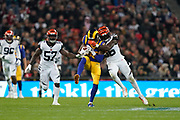 LA Rams Wide Receiver Josh Reynolds (83) is tackled during the International Series match between Los Angeles Rams and Cincinnati Bengals at Wembley Stadium, London, England on 27 October 2019.