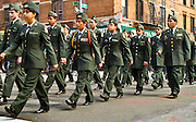 Young ROTC members marching at a local parade.