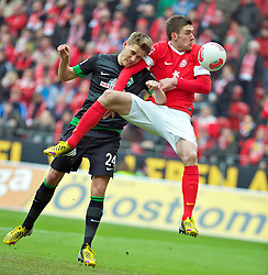 30.03.2013, Coface Arena, Mainz, GER, 1. FBL, 1. FSV Mainz 05 vs SV Werder Bremen, 27. Runde, im Bild Nils Petersen (Bremen #24) im Kopfballduell mit Stefan Bell (1. FSV Mainz 05 #16) // during the German Bundesliga 27th round match between 1. FSV Mainz 05 and SV Werder Bremen at the Coface Arena, Mainz, Germany on 2013/03/30. EXPA Pictures © 2013, PhotoCredit: EXPA/ Andreas Gumz ***** ATTENTION - OUT OF GER *****